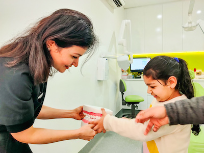 Dental at Niddrie Plaza - Dr Raman with Patient